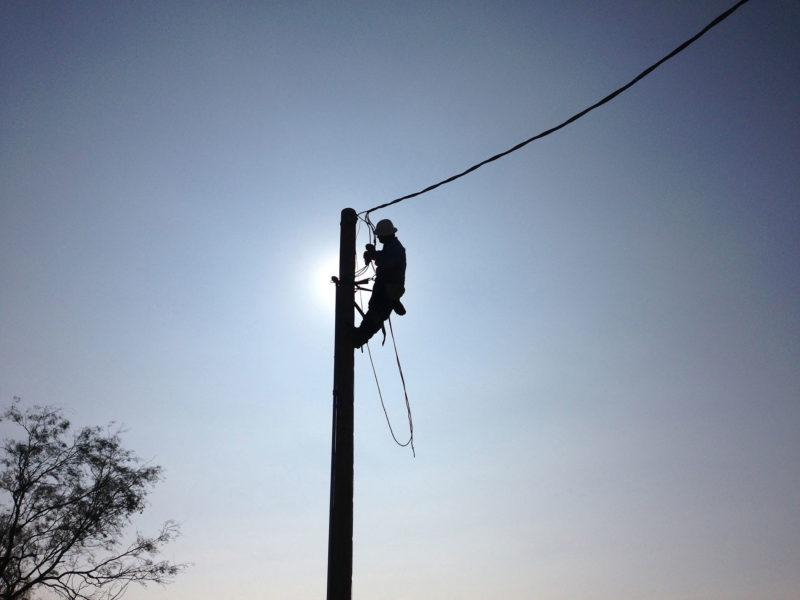 lineman on power pole