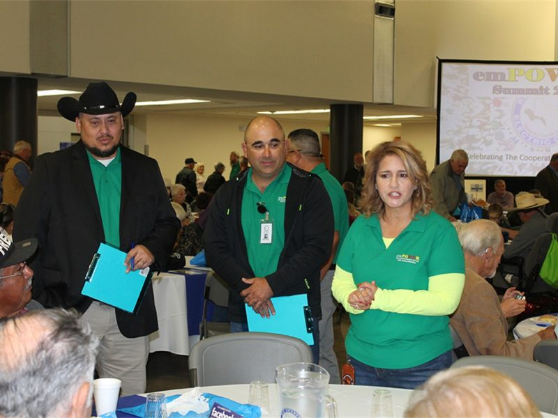 staff at annual meeting speaking with members