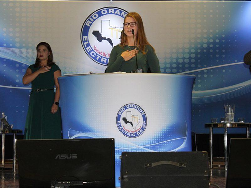 two women speaking pledge of allegiance
