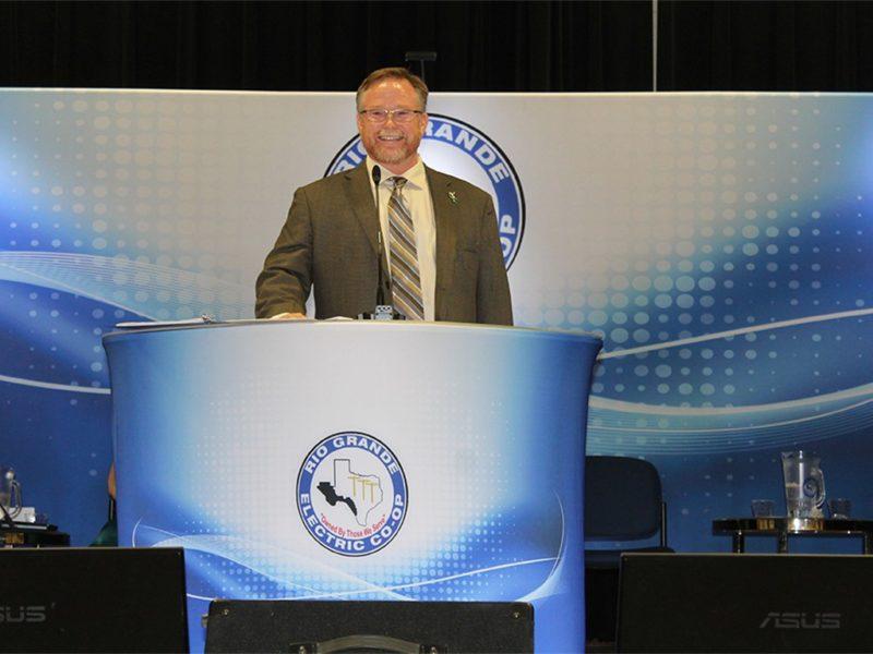 man in front of podium